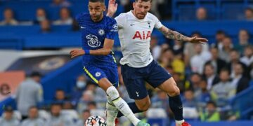 Chelsea's Moroccan midfielder Hakim Ziyech (L) vies with Tottenham Hotspur's Danish midfielder Pierre-Emile Hojbjerg (R) during the pre-season friendly football match between Chelsea and Tottenham Hotspur at Stamford Bridge in London on August 4, 2021. - RESTRICTED TO EDITORIAL USE. No use with unauthorized audio, video, data, fixture lists, club/league logos or 'live' services. Online in-match use limited to 75 images, no video emulation. No use in betting, games or single club/league/player publications. (Photo by Glyn KIRK / AFP) / RESTRICTED TO EDITORIAL USE. No use with unauthorized audio, video, data, fixture lists, club/league logos or 'live' services. Online in-match use limited to 75 images, no video emulation. No use in betting, games or single club/league/player publications. / RESTRICTED TO EDITORIAL USE. No use with unauthorized audio, video, data, fixture lists, club/league logos or 'live' services. Online in-match use limited to 75 images, no video emulation. No use in betting, games or single club/league/player publications. (Photo by GLYN KIRK/AFP via Getty Images)